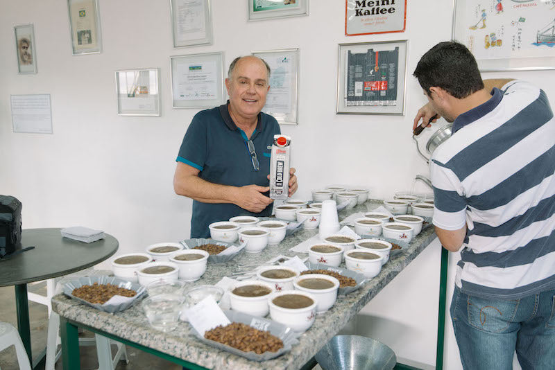 Tulio cupping with his favourite carton of cold brew!