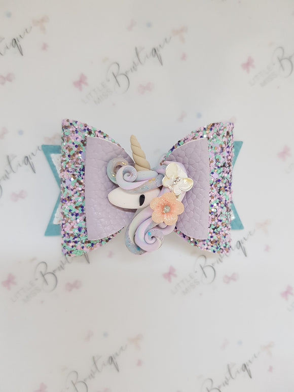 Pretty swirls unicorn bow