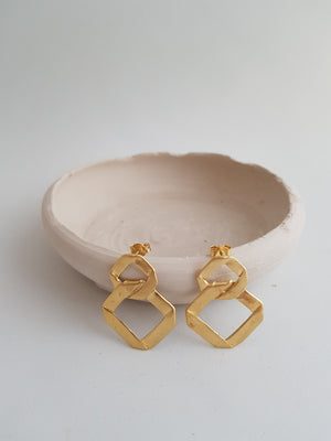 Statement rhombus earrings gold plated. Big geometric earrings for a contemporary woman.