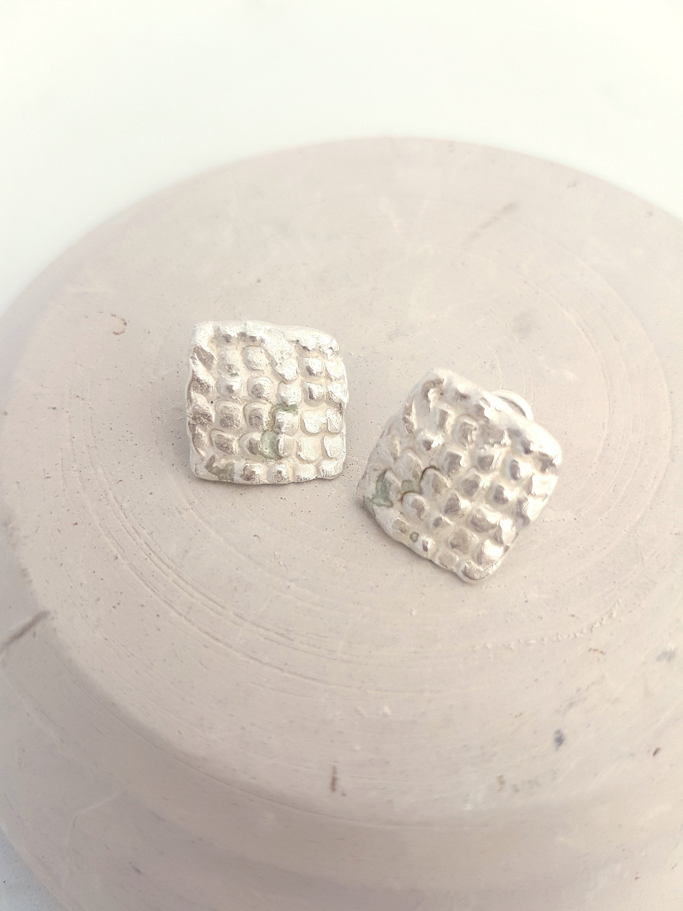 Silver square studs with an organic texture. Textured post earrings in sterling silver