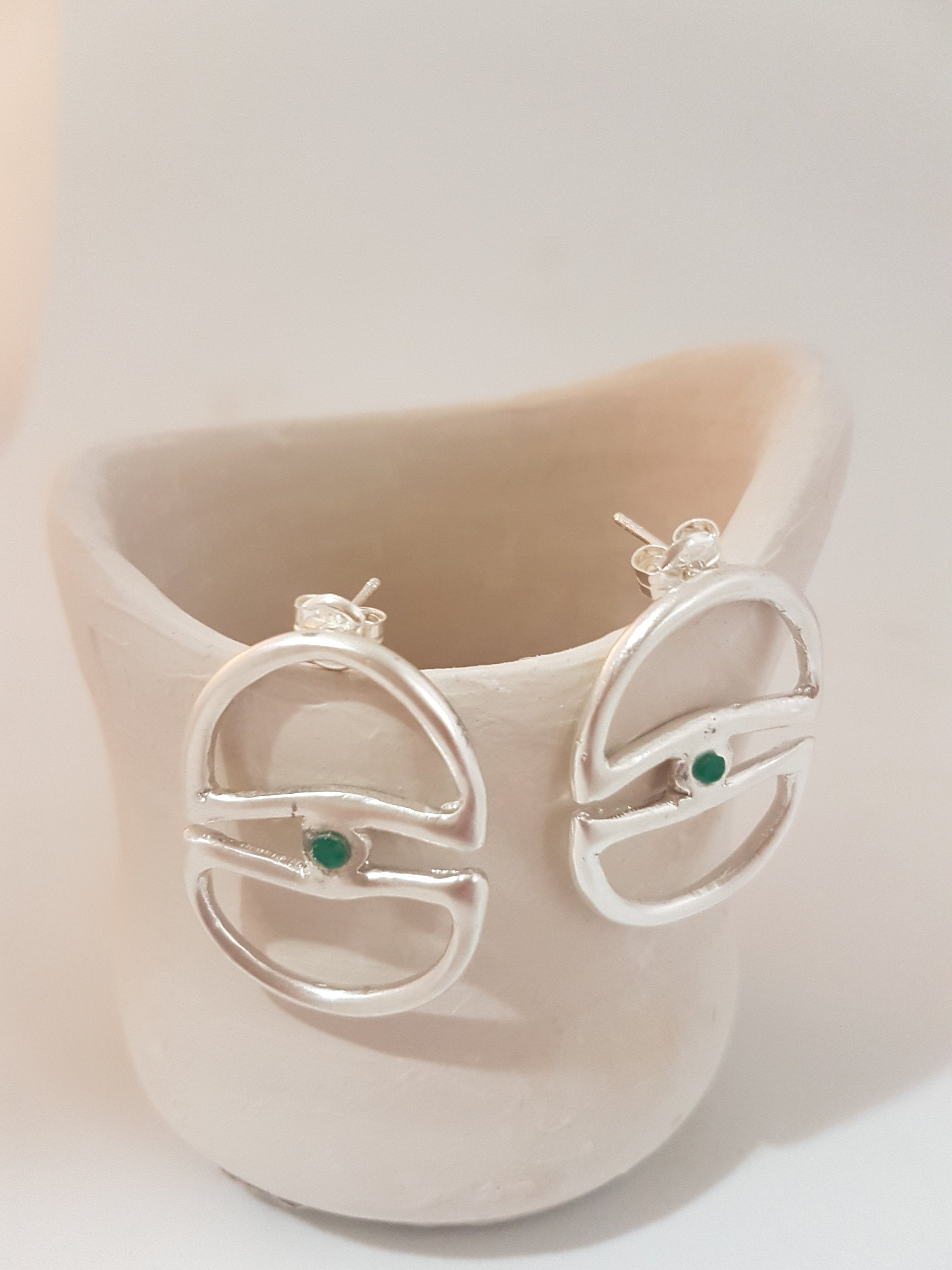 Big bold earrings in sterling silver with emeralds. Artistic statement earrings