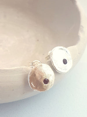 garnet stud earrings. Round silver earrings with garnets