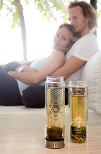 Load image into Gallery viewer, The Lotus Glass Tea Tumbler with Infuser + Strainer for Loose Leaf Tea, Coffee and Fruit Water. Inc Travel Sleeve. 15oz Bottle with Bamboo Lid. Perfect Gift. Soulful Design. Beautifully Packaged.