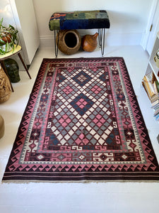 Kilim Rug in tones of Browns and Pinks.