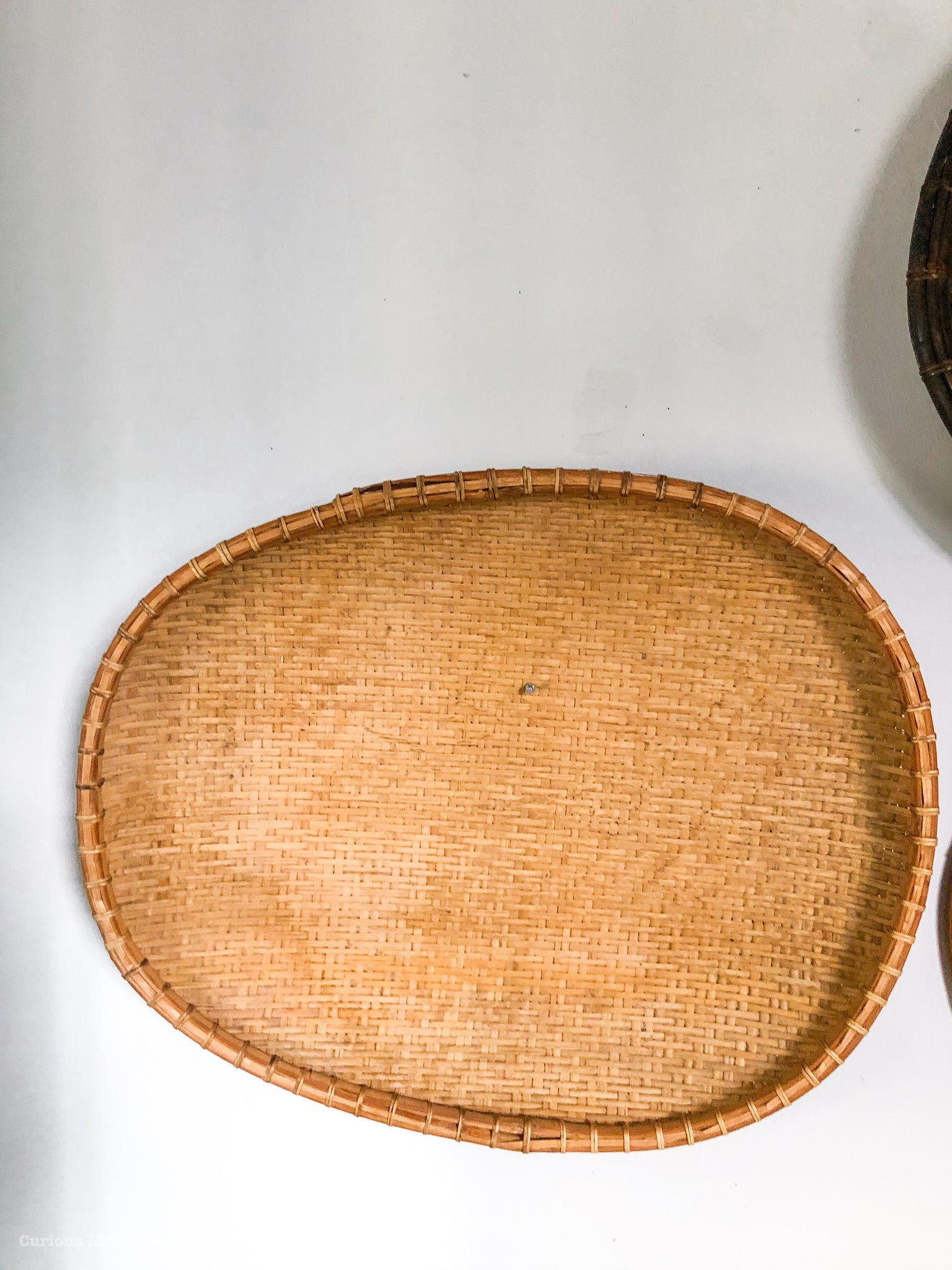 Curated Asian Basket Collection for the Wall. Vintage Winnowing Baskets and an Antique Coolie Rice Paddy Hat from the 50's.