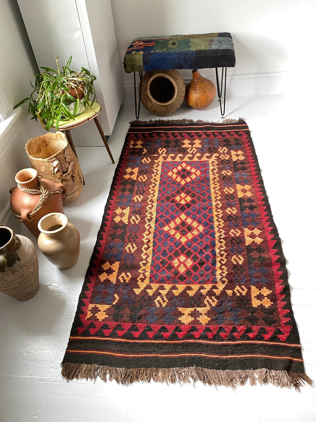 Mid Century Afghan Kilim Area Rug in Dark Reds, Blue Greys, and Browns.
