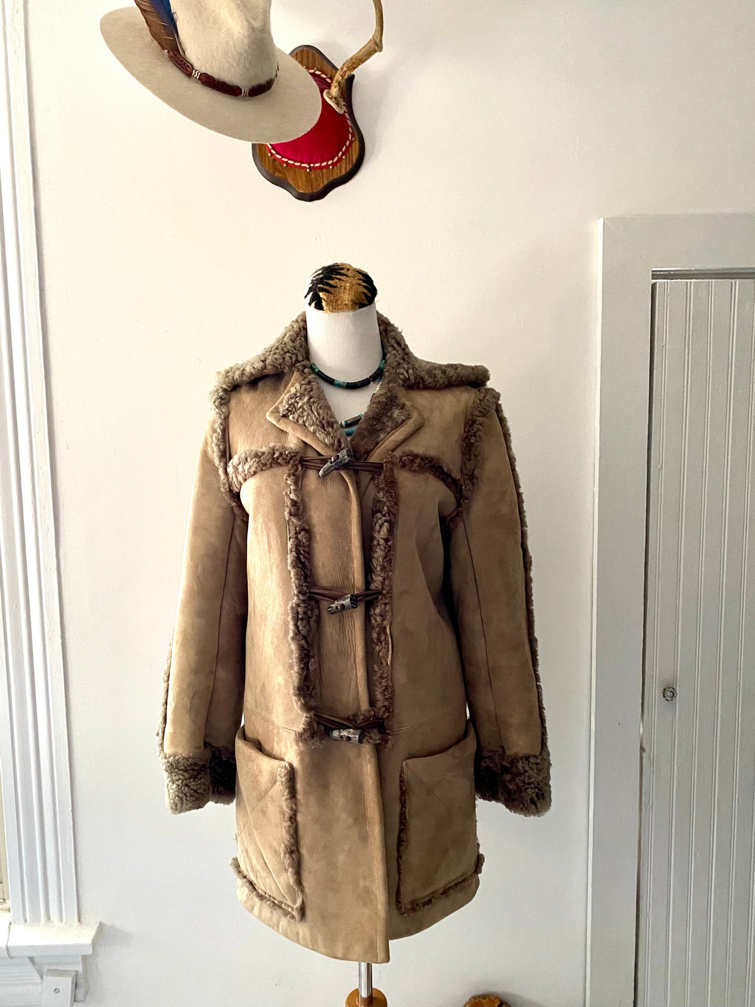 Vintage Women's McPhail & Fisher New Zealand Brown Sheepskin Shearling Coat with toggles.
