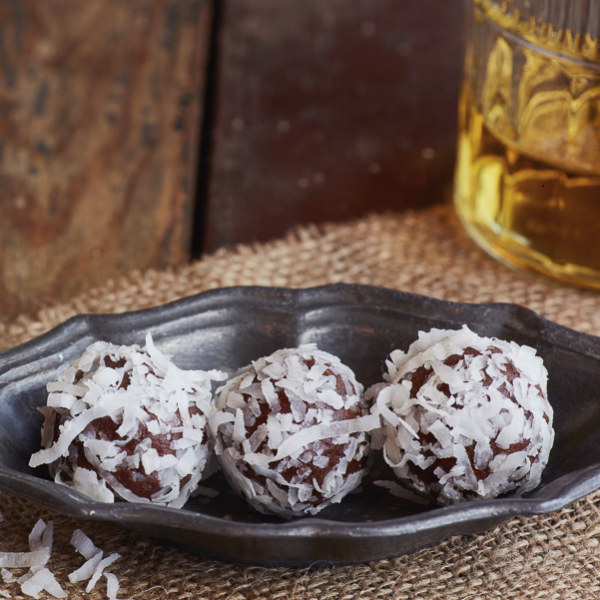 McCormick Caribbean Rum blended with Belgian dark chocolate, rolled in coconut.  Kansas City Gifts.  Kansas City Chocolate.