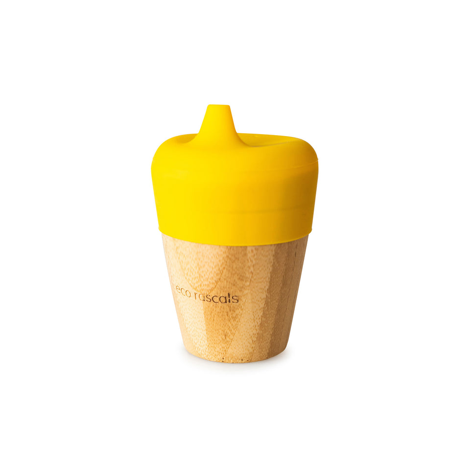 Small cup with yellow sippy feeder