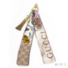 Bag Charm made from a Vintage Gucci Scarf in a Floral & Gucci Logo Print