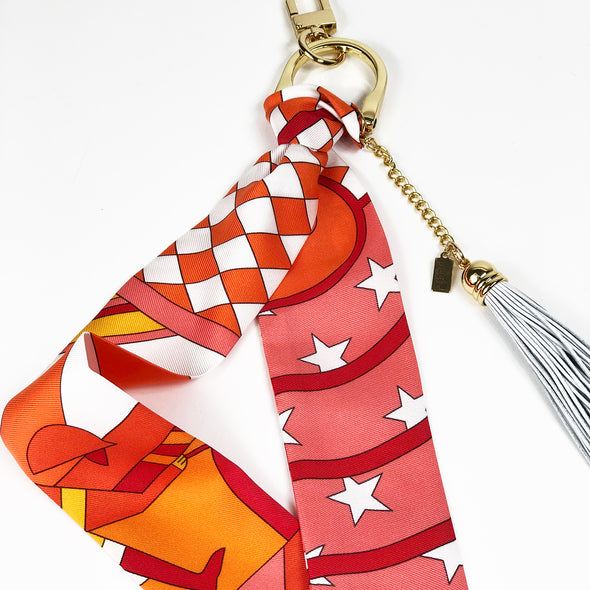 Hermès Vintage Scarf Bag Charm made from 'Steeple Chase' in Orange