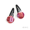 Pair of Vintage Hermès Scarf Hair Clips made from 'Bolduc Au Carre' Dark Pinks