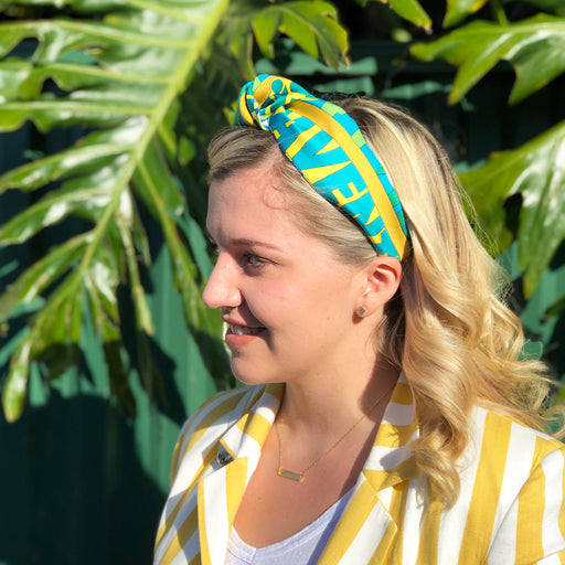Stephanie Ferrara wearing  Hermès Vintage Scarf Knot Headband made from 'Mots de Soie'
