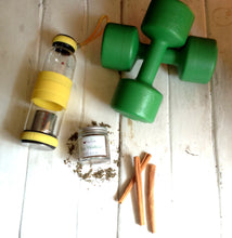 A bottle of Post Workout Tisane and an infuser gym bottle