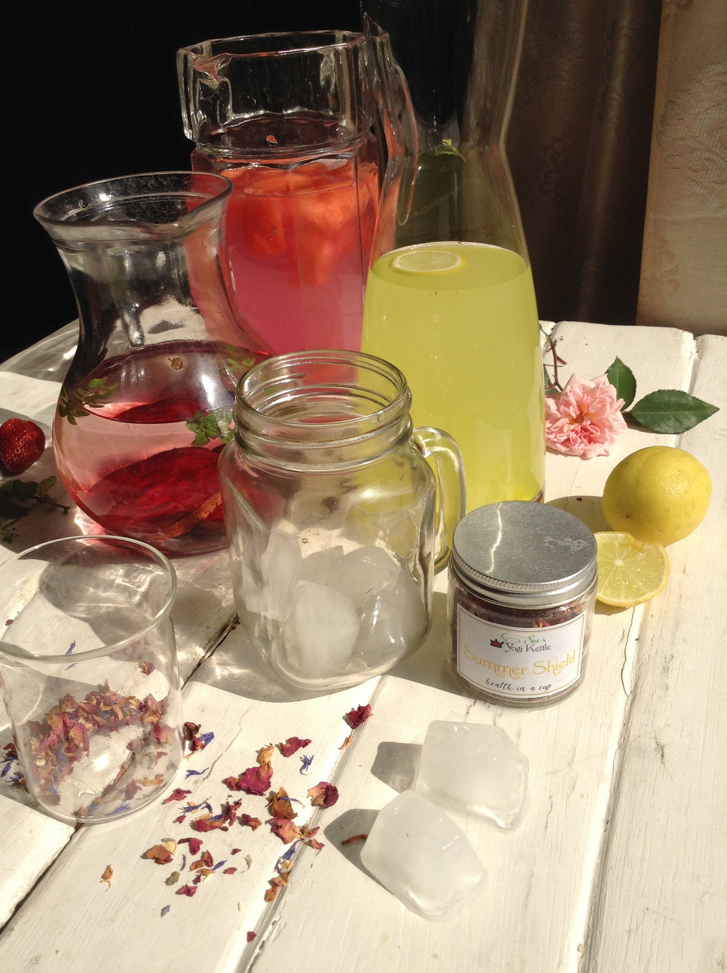 A freshly brewed batch of cold Summer Shield Tisane in a glass jug by Sue's Yogi Kettle