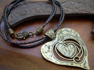Antique Bronze Heart Pendant On A Leather Necklace