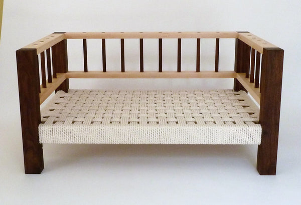 Slumber Wolf Belvoir Dog Bed in Walnut and Maple with stone wool topper removed to reveal rope weave