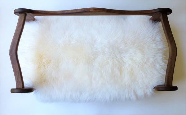 Slumber Wolf Pomeroy Dog Bed with Walnut frame and white wool topper from above to show curved rails