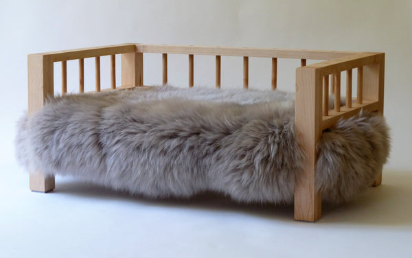 Maple Belvoir Slumber Wolf dog bed with stone wool topper from a side angle