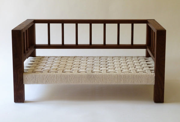 Walnut Belvoir Slumber Wolf dog bed with white wool topper removed to show rope weave underneath