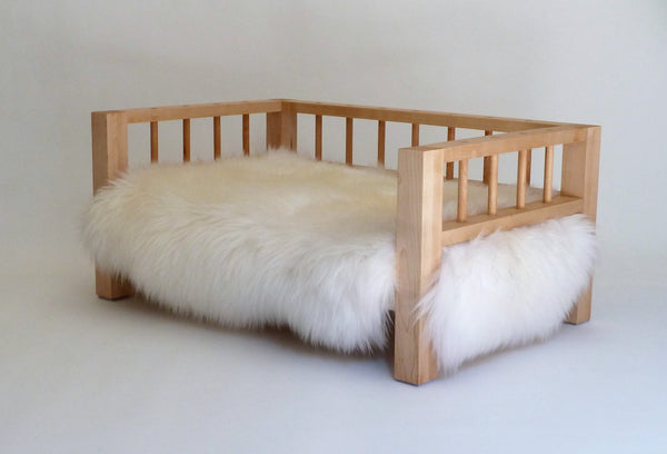 Maple Belvoir Slumber Wolf dog bed with white wool topper