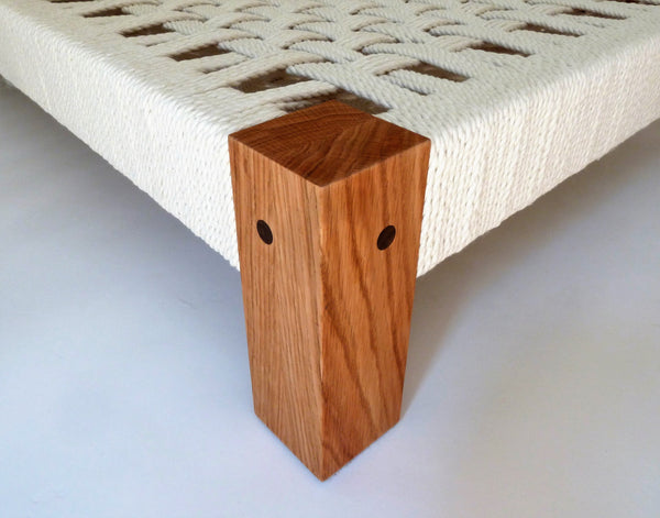 Close up of Arundel Slumber Wolf dog bed showing walnut pegs for the mortise and tenon joints
