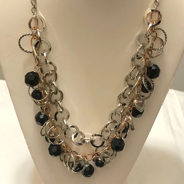 How to wear the on trend layered necklace look.