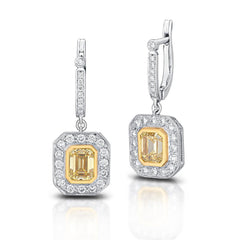 15901 Platinum drop earrings featuring 2.65 total carats of emerald cut fancy intense yellow diamonds with VVS1-VS1 clarity and 1.05 total carats of round brilliant cut diamonds.