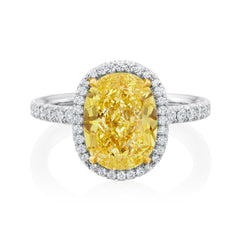 Platinum halo ring set with a 4.12 carat oval cut Fancy Intense Yellow diamond with SI1 clarity and 0.47 total carats of round brilliant cut diamonds 24148