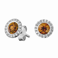 28727 14kt white gold halo earrings centered with 1.15 total carats of round brilliant cut orange colored diamonds surrounded by 0.34 total carats of round brilliant cut diamonds