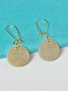 Gold and Cream disc dangle earrings.