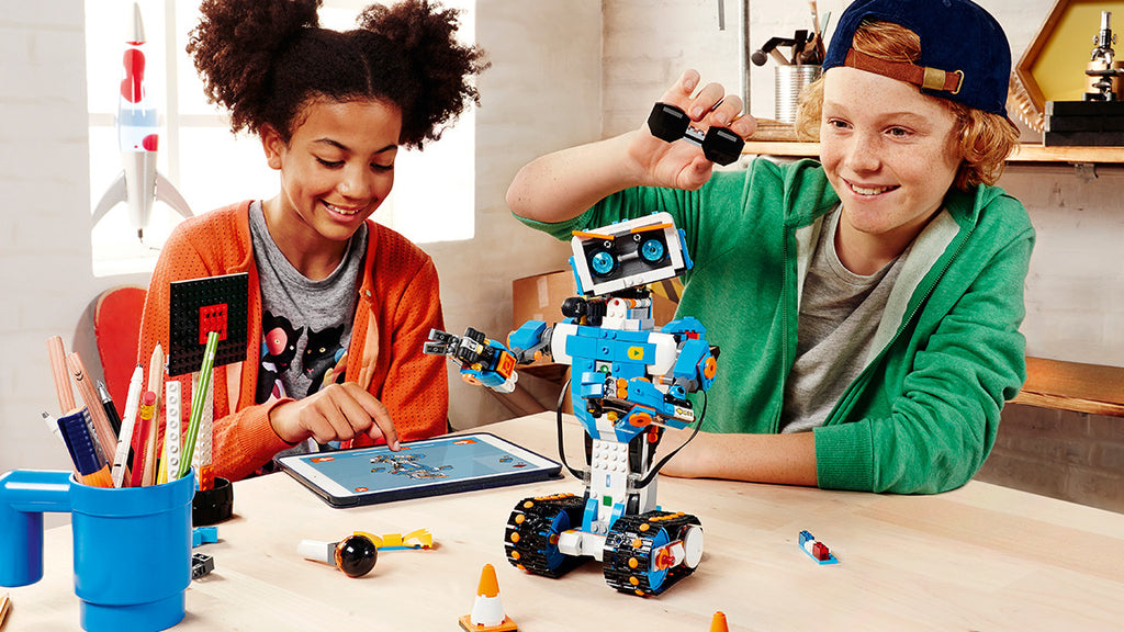 Girl and boy building Vernie Boost lego toolkit top smart toy robot for girls code and robotics STEM