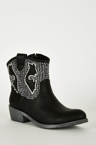 Black and silver boot