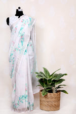 PALE PINK HAND WOVEN LINEN SAREE WITH WATER COLOR CHERRY - Tina Eapen Design Studio