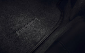 Floor mats with leather trim