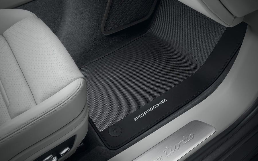Carbon floor mats with leather edging