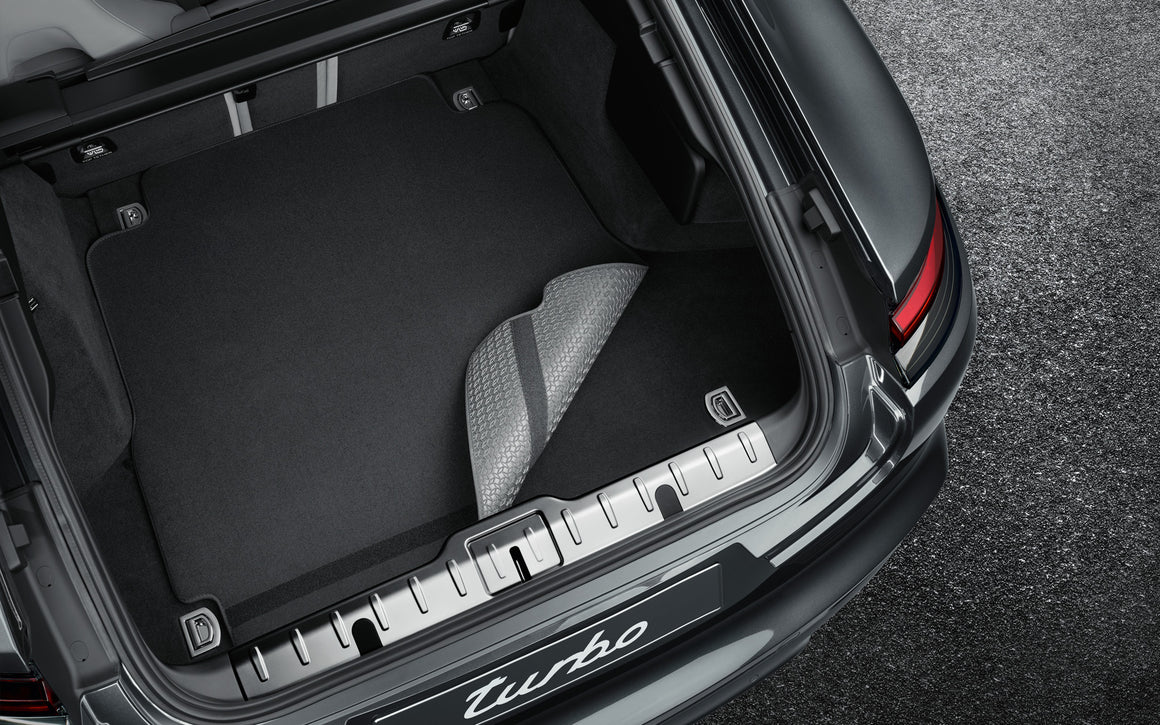 Reversible luggage-compartment mat with Nubuk surround