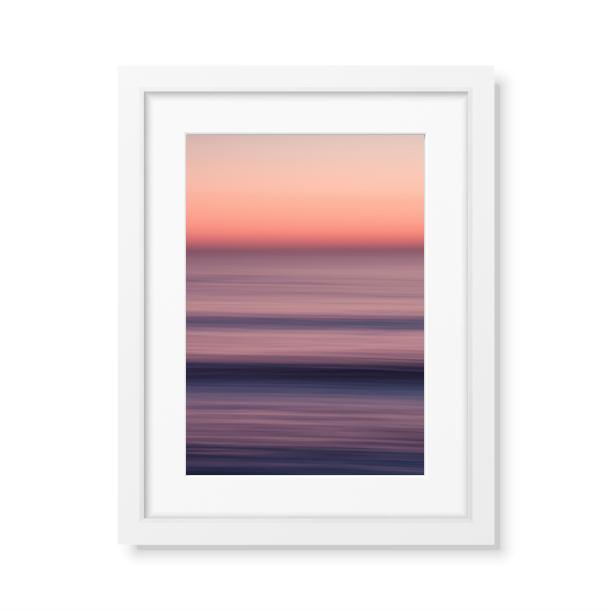 A framed fine art print of the ocean at sunset