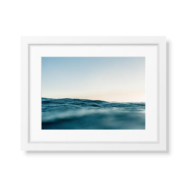 A framed fine art print of a calm ocean