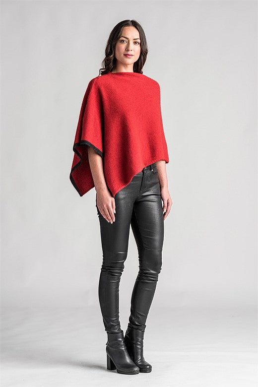 Asymmetric Poncho in block colour with contrast colour on one edge. Multiple colours available.
