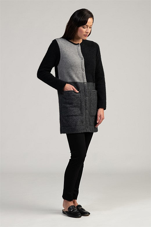 Ladies Long button up jacket/cardigan. Deep pockets, button front, bold colour blocking. Possum Merino wool.