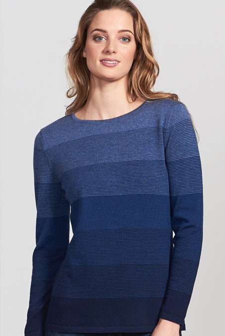 Ladies crew neck long sleeve jumper. Graduated colour horizontal stripes lighter at the neck going to darker at base. Merino Wool Jumper