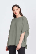 Ladies loose fit top in garter stitch. Tunic style with open sleeve look. Merino wool knit.