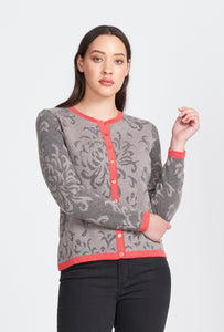 Ladies long sleeve, button front cardigan. Floral pattern with contrast trim. 100% Superfine Merino fibre.