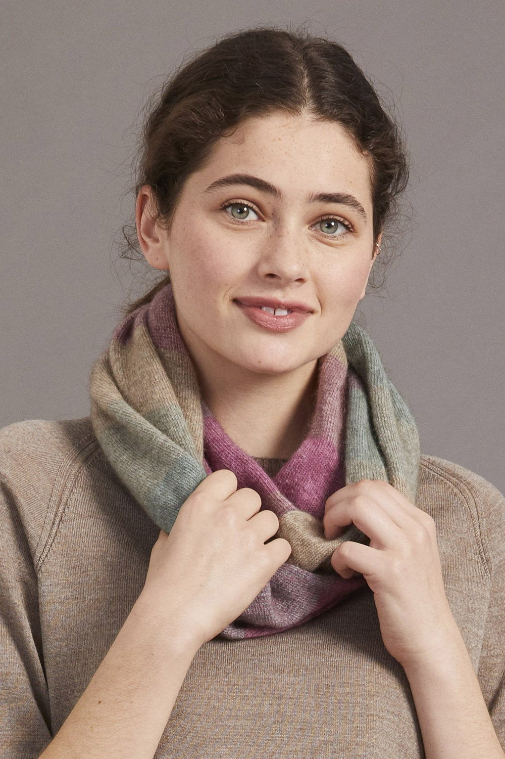 Ombre coloured snood. Worn as a scarf or as a hair covering.
