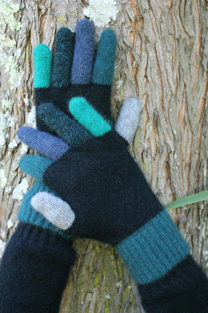 Gloves with multi coloured fingers and cuff.  Possum Merino blend.