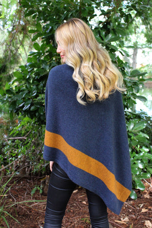 Women's asymmetric poncho with patterned front and two colours. Possum Merino wool.