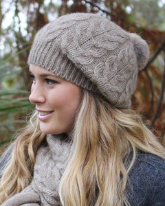Baggy beanie with cable knit and rabbit fur pom pom.