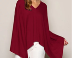 Ladies poncho, throw, wrap.  Asymmetrical or can be worn straight across.