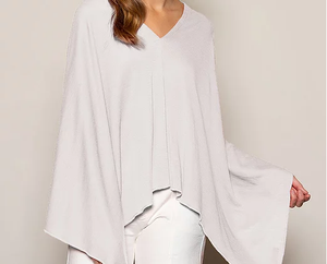 Women's poncho, throw, wrap. Asymmetrical or can be worn straight across. Merino wool.